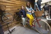 British Bicycle Company manager Kari Bynum and shop owner Lindsey Andersen-Kohrt show off one of the bike shop's British-made bicycles.
