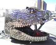 Levine often drives around downtown Phoenix in a golf cart he turned into a metal rattlesnake head. Levine is owner of real estate company Levine Machine LLC.