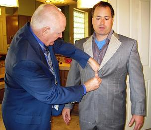 Steve Wilson, owner of Phoenix-based S.W. Wilson Bespoke Clothiers, measures a client for a new suit.