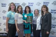 Cancer Treatment Centers of America employees pose at the Healthiest Employers breakfast March 21. The health care provider was No. 2 on the list of medium-sized businesses.