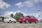 The 2012 Volkswagen Beetle and an original.