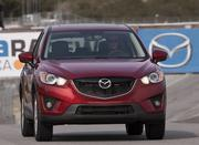 Mazda CX5, $21,490: The CX5 is a brand-new entry from Mazda in the crowded field of compact crossovers, and it stands out with fuel economy up to 35 mpg, a fun-to-drive personality, sharp looks inside and out, and comfy surrounds.