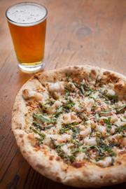 Pizza and a beer from Humble Pie, which will soon have two locations at Phoenix Sky Harbor International Airport.