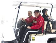 Diamondbacks Managing General Partner Ken Kendrick (in hat) and team President Derrick Hall take a ride in a golf cart to check out the freak Phoenix snowstorm.