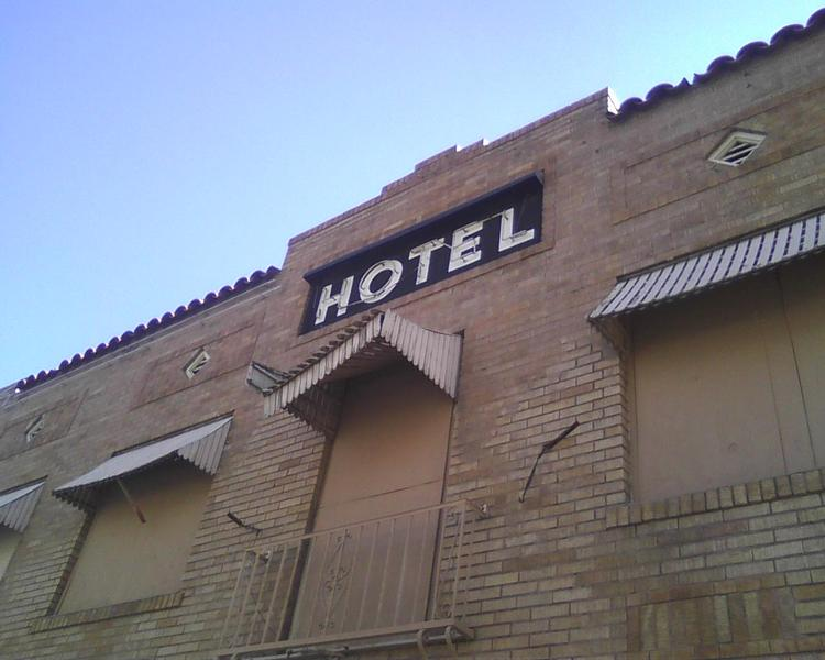 The Phoenix Suns are considering demolishing two older motels next to US Airways Center in downtown Phoenix.