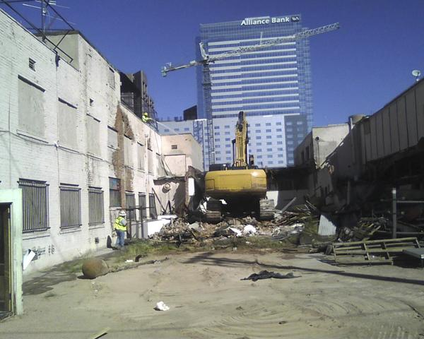 Demolition crews were at work Wednesday morning tearing down the St. James and Madison Hotel buildings next to US Airways Center in downtown Phoenix.