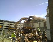 Crews work to demolish the old hotels.