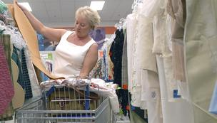 A shopper browses at a Phoenix-area Goodwill store.