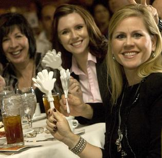 Govig & Associates employees Bess Cadwell (left), Chaz Vaughn and Jacque Linaman celebrate at the Phoenix Business Journal's Best Places to Work awards Thursday afternoon.
