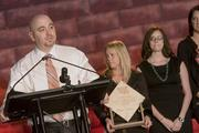 Employees from Quicken Loans accept their award as the No. 1 company in the large company category.