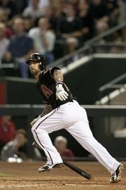 ...and watches it fly out of the park. The homer gave the D-backs a 4-1 lead in the first inning.
