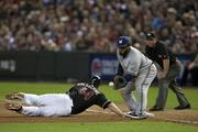 Paul Goldschmidt scampers back to first base.