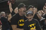 David Wellnitz and his son J.D. celebrate after the final out.