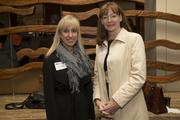 Tami Steinbrick, left, and Maureen Musselman pause for the camera at the 2013 Dynamic Women in Business event.