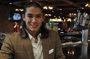 Booboo Stewart, from the hit movie Breaking Dawn, sits at the corner of the Luxe Lounge bar.