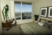 One of the bedrooms in a penthouse unit.