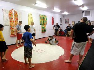 Mixed martial arts classes, like this one at Eclipse MMA Gym in South Tucson, are growing in popularity across Arizona. The sport is evolving around new fighting styles and techniques.