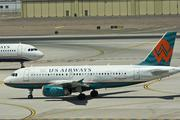 May 2005: America West Airlines and US Airways hold a joint news conference to announce a merger.