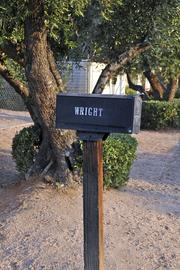 The mailbox still bears the Wright name.