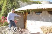 Joffe points to the signature tile on the exterior of the home, which is signed by Frank Lloyd Wright.