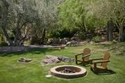 A sitting area on the property includes a fire pit.