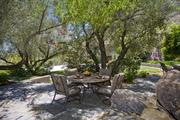 A naturally shaded outdoor seating area.
