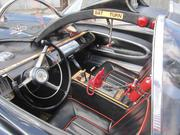 The car features instruments housed in the steering wheel and a push-button transmission.