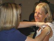 Marjorie Bessel, M.D., Banner Health's Arizona east region medical officer, gets a flu shot.