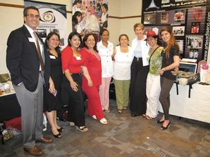 Women in the Goldman Sachs 10,000 Women Initiative pose with Gonzalo de la Melena, Jr., CEO of the Arizona Hispanic Chamber of Commerce, and Barbara Barrett (third from right), interim president of Thunderbird.