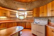 The kitchen. Much of the fixtures and furnishings in the home were made from Philippine mahogany.