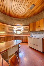 The circular window in the kitchen was one of Frank Lloyd Wright's design features in the home.