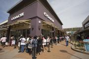 Coach proved to be a popular destination for Premium Outlets shoppers on the center's opening day April 4. The store's line snaked around the building.