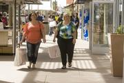 """Chandler resident Sarena Appleton (left) and Gilbert resident Cathy Cannavo said the opening of Phoenix Premium Outlets is a positive sign for the economy. """"You see people walking around with shopping bags,"""" Appleton said. """"It's something very needed on this side of town."""""""