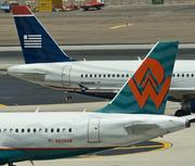 2005:America West Holdings and US Airways Group, Inc. announce plans to merge on May 19. Former America West Airlines Chairman and Chief Executive Officer Doug Parker is chosen to run the combined airline. The merger transaction is officially complete on September 27, and US Airways Group, Inc. is no longer in bankruptcy.