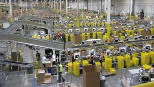 Workers shift packings in the sorting center at Amazon.com's newest distribution center in Phoenix. The 1.3 million-square-foot center opened last year.