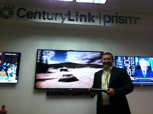 Ken McMahon, CenturyLink's vice president and general manager of the Phoenix metro area, holds the residential gateway modem that provides the Prism TV video content in the Prism TV demonstration room in the downtown Phoenix office.