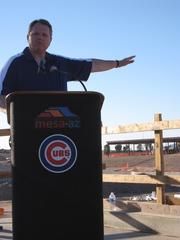 Mayor Smith starting his presentation overlooking one of the bullpens and the grass seating berm beyond the outfield.