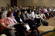 A packed room of attendees listen during a breakout session at the Nonprofit Business Summit.