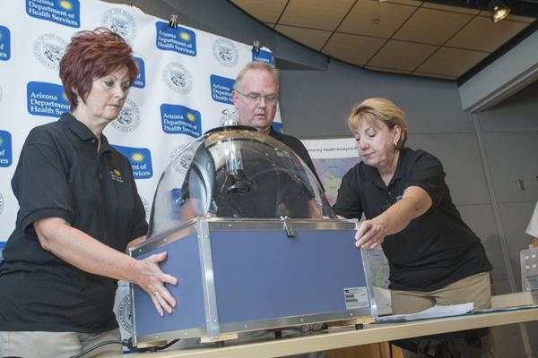 The Arizona Department of Health Services audit and investigations team conducted the random drawing. From left, Connie Phillips, Kurt Schulte and Alex Percival.