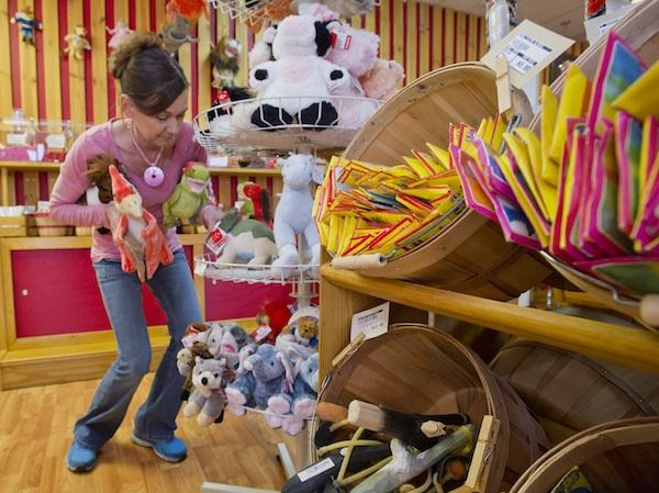 Jeanine Rometty, owner of Old Town Candy and Toys in Scottsdale, stocks the racks in anticipation of Small Business Saturday.