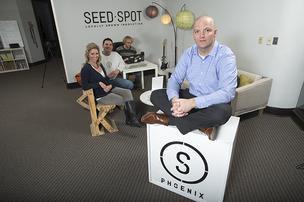 Ryan Berry, right, an attorney with Polsinelli Shughart PC in Phoenix, is using his experience from a failed entrepreneurial effort to help others. He's working with, from left, Seed Spot co-founders Courtney Klein Johnson and Chris Petroff, along with Seed Spot intern Chris Cornell.