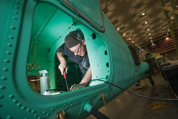 Jason Pulkkinen, a production/assembly technician for Boeing Co., works on the Apache Block III helicopter production line in Mesa.