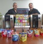 Mesa's Esio prepares hot/cold beverage dispenser for Walmart shelves