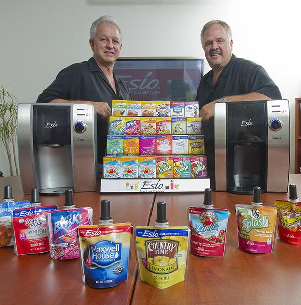 Esio CEO Frank Leonesio, left, and President Lyle Myers show off their countertop beverage system.