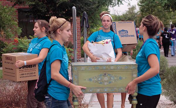 Grand Canyon University students help move a crop of freshmen into new dorms that opened this fall. The campus, at 3300 W. Camelback Road in Phoenix, has 6,500 students this year. The university's expansion plans call for accommodating 15,000 by 2015.