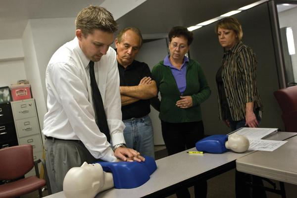 Chad Wentz, human resources manager at Home Instead Senior Care of Greater Phoenix, gives CPR training to potential caregivers, from left, John Ornelas, Julie  Vecserine and Devona Pearson. Home Instead's owners purchased the business with a $1.6 million SBA-backed loan from Wells Fargo & Co.