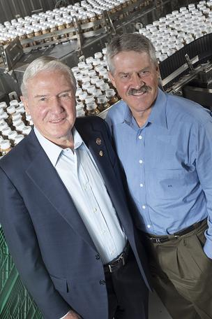 Shamrock Foods Chairman Norman McClelland, left, and his son, Kent, are the second and third generations to lead the company, which owns Shamrock Farms.