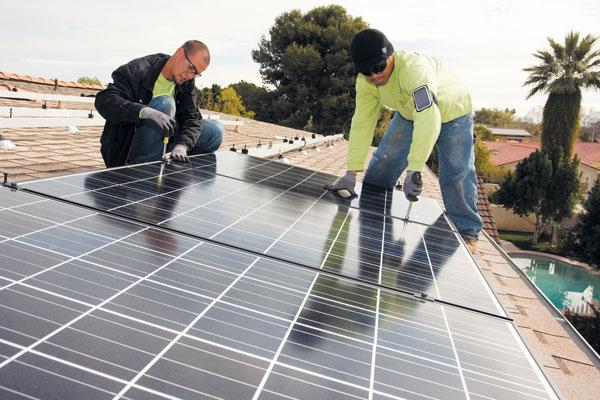 Workers for American Solar Electric Inc. install rooftop panels on a Valley home. Sean Seitz, president and co-owner of the Scottsdale company, says he doesn't expect prices to increase significantly as a result of federal tariffs on Chinese solar components.