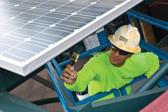 Steve Bagnani, an iron worker with Ironco Enterprises LLC, adds the finishing touches to the solar panel supports recently installed at Chase Field in downtown Phoenix.