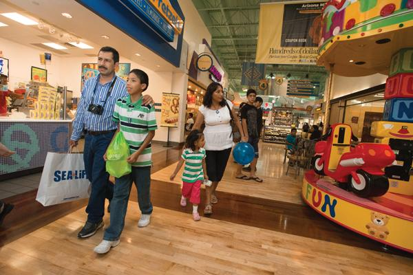 Gerardo Veliz and Beatriz Romero, visiting from Mexico with their children, Francisco and Anna, walk through Arizona Mills after visiting Sea Life Aquarium.